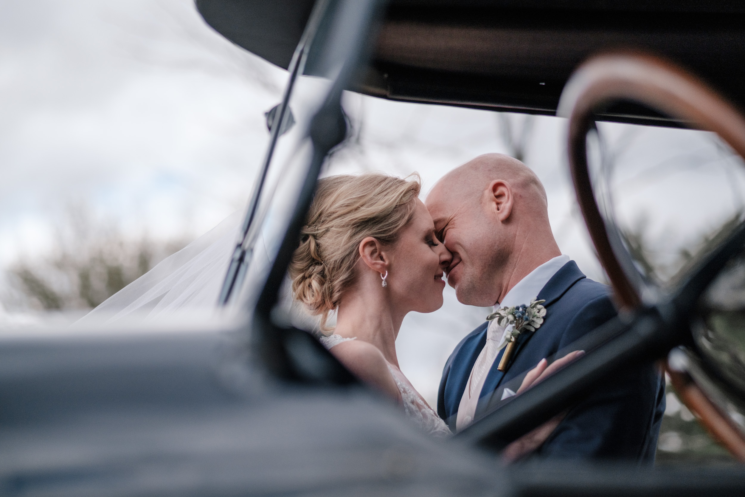 natural portrait of bride and groom embracing on wedding day at the brix