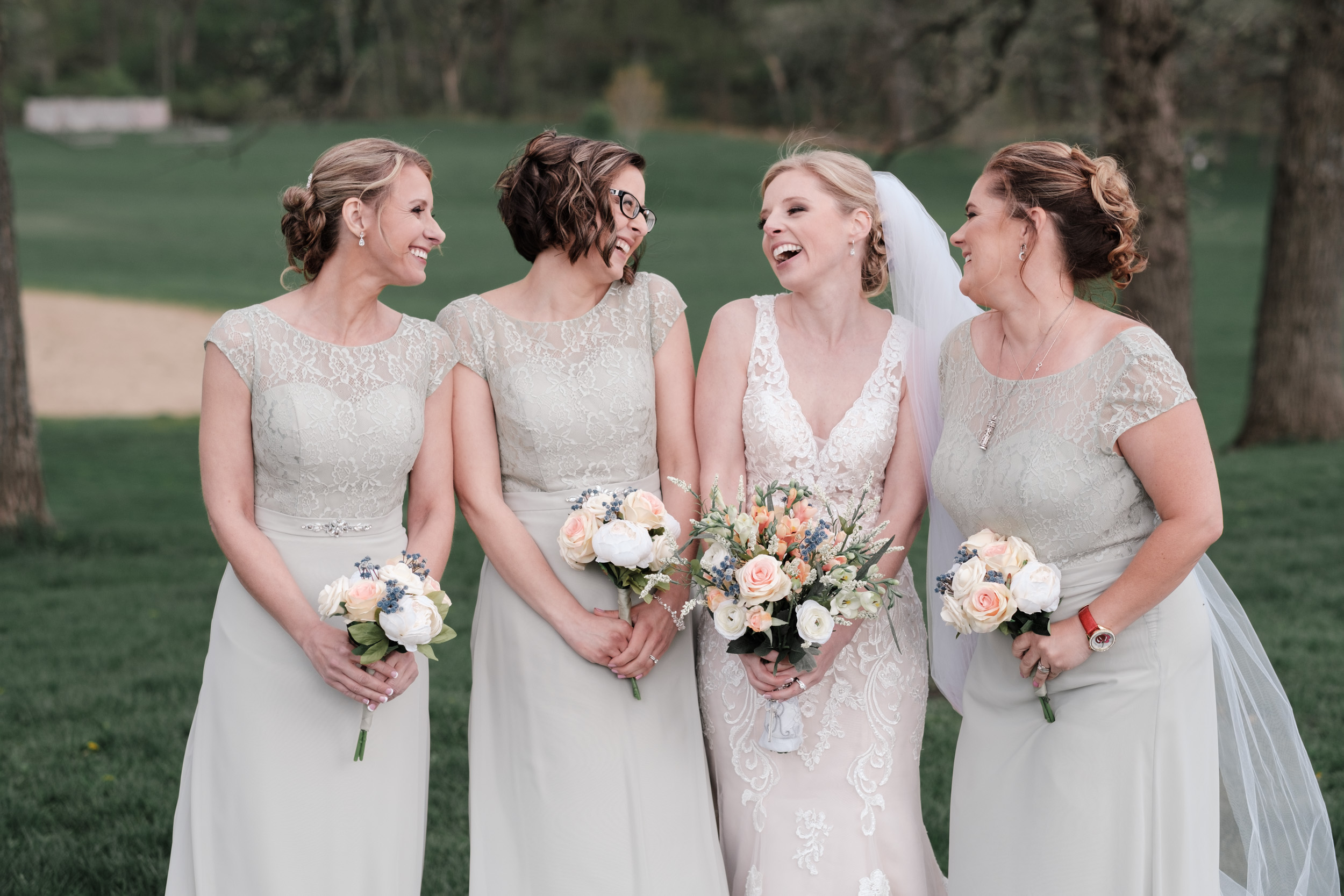 candid portrait of bride and bridesmaids on wedding day