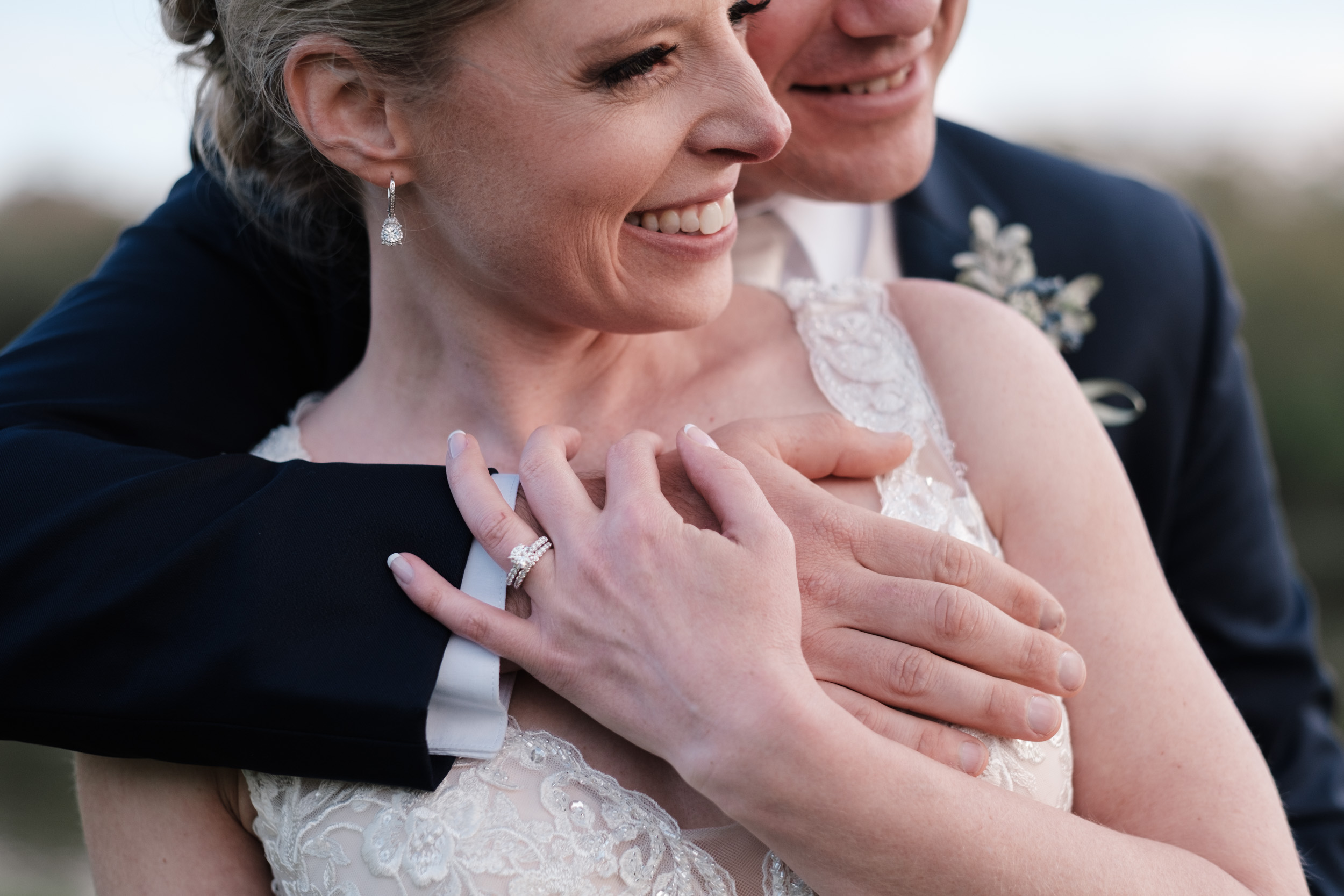groom hugging bride on wedding day at the brix