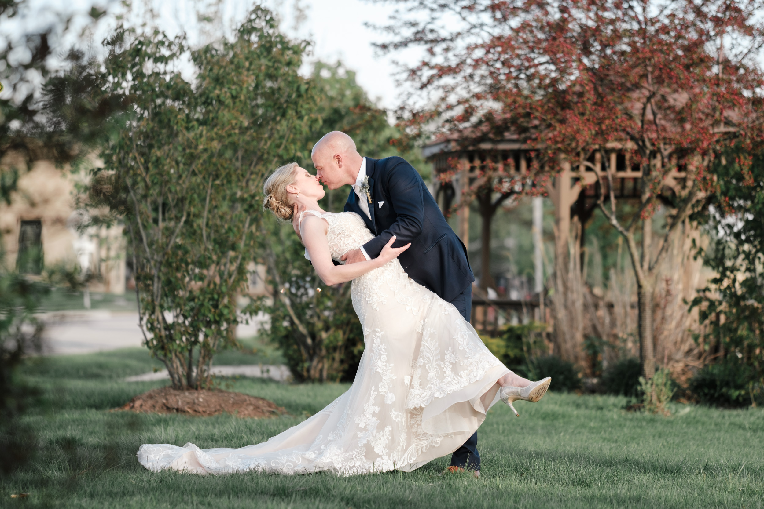 wedding day dip of love with laughs and kiss at the brix
