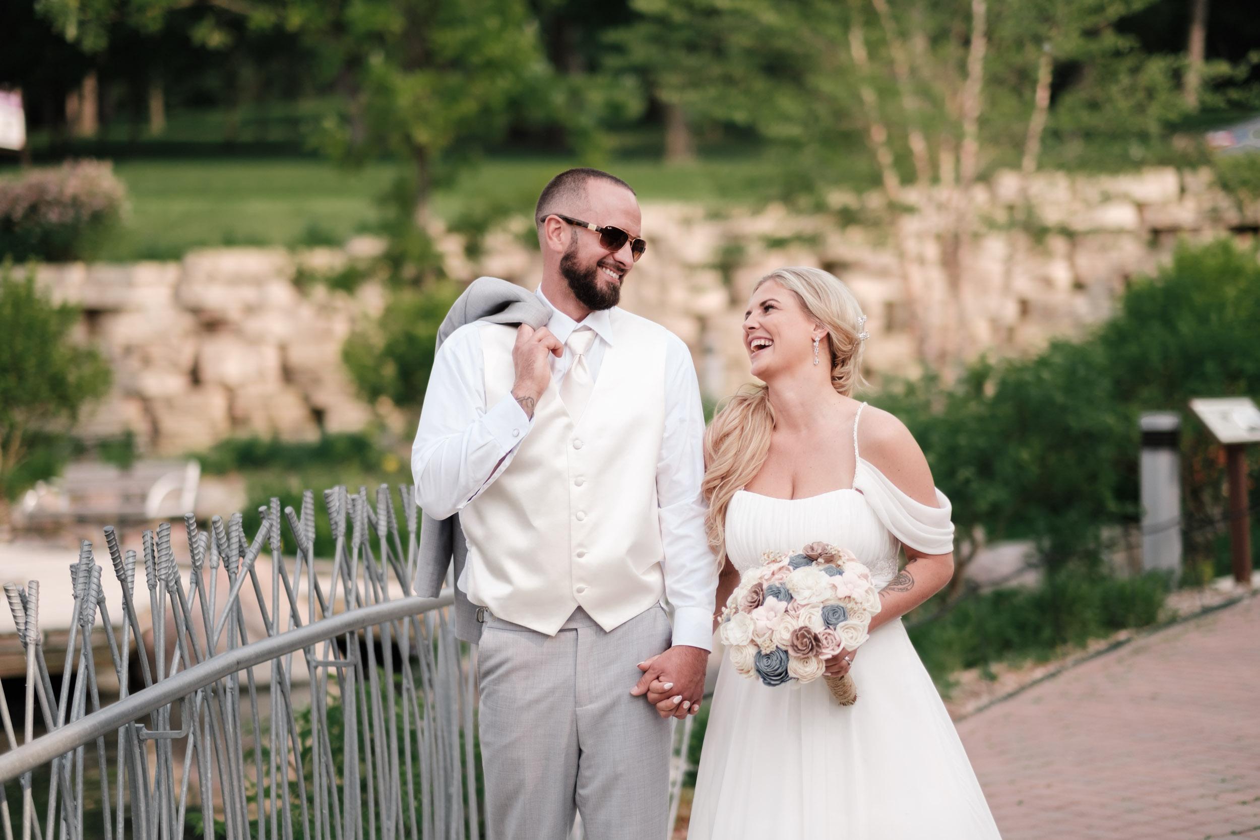 rockford candid wedding couple laughing on bridge