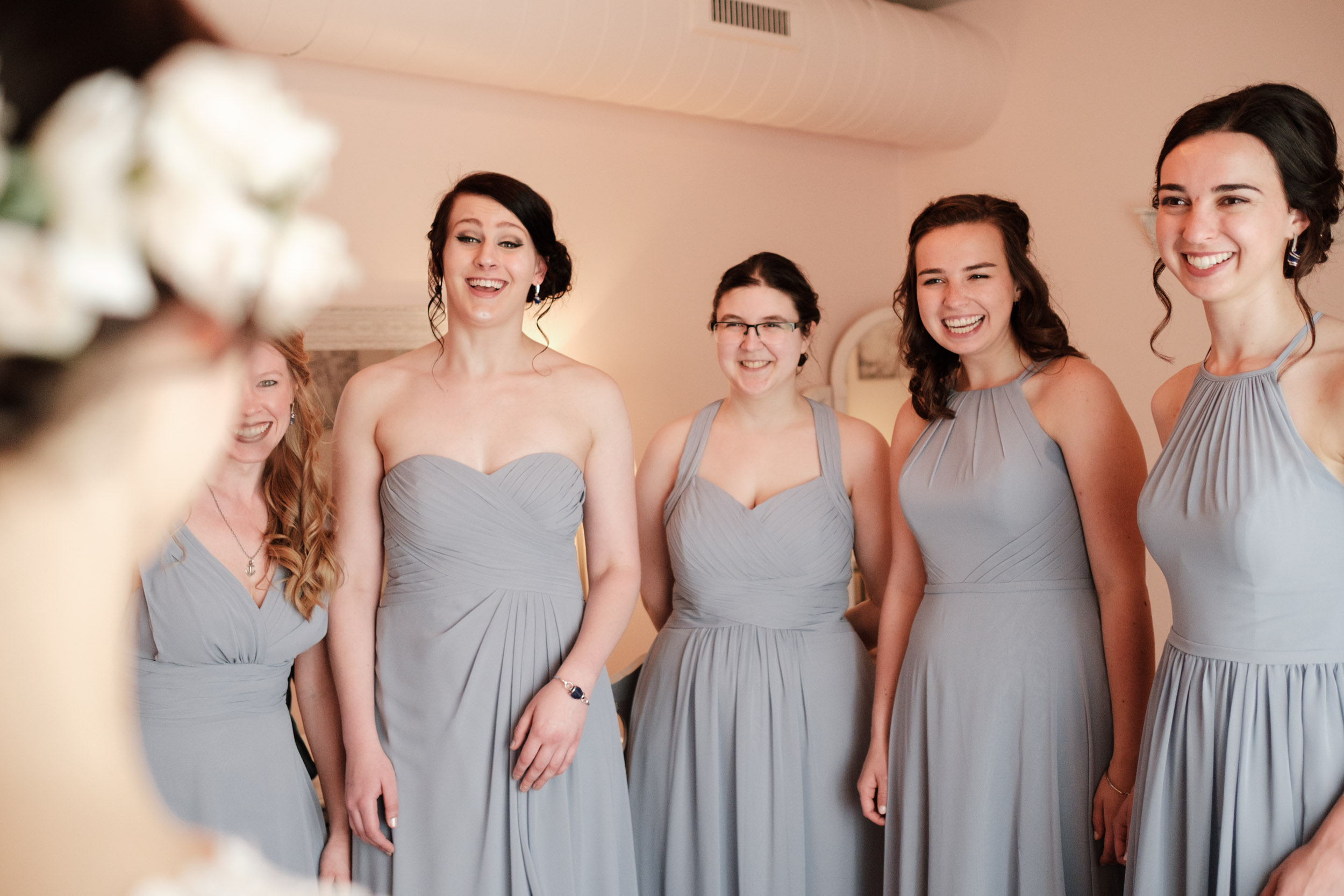 blue dress bridesmaids dresses first look of bride at gardens of woodstock on wedding day