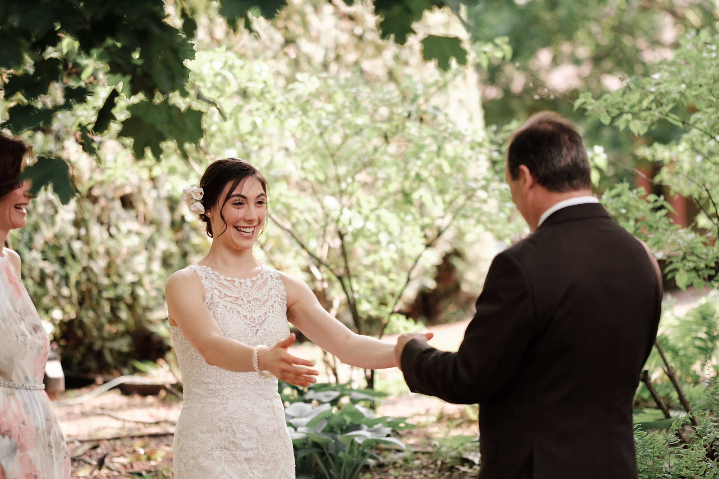 bride first look with father at gardens of woodstock wedding