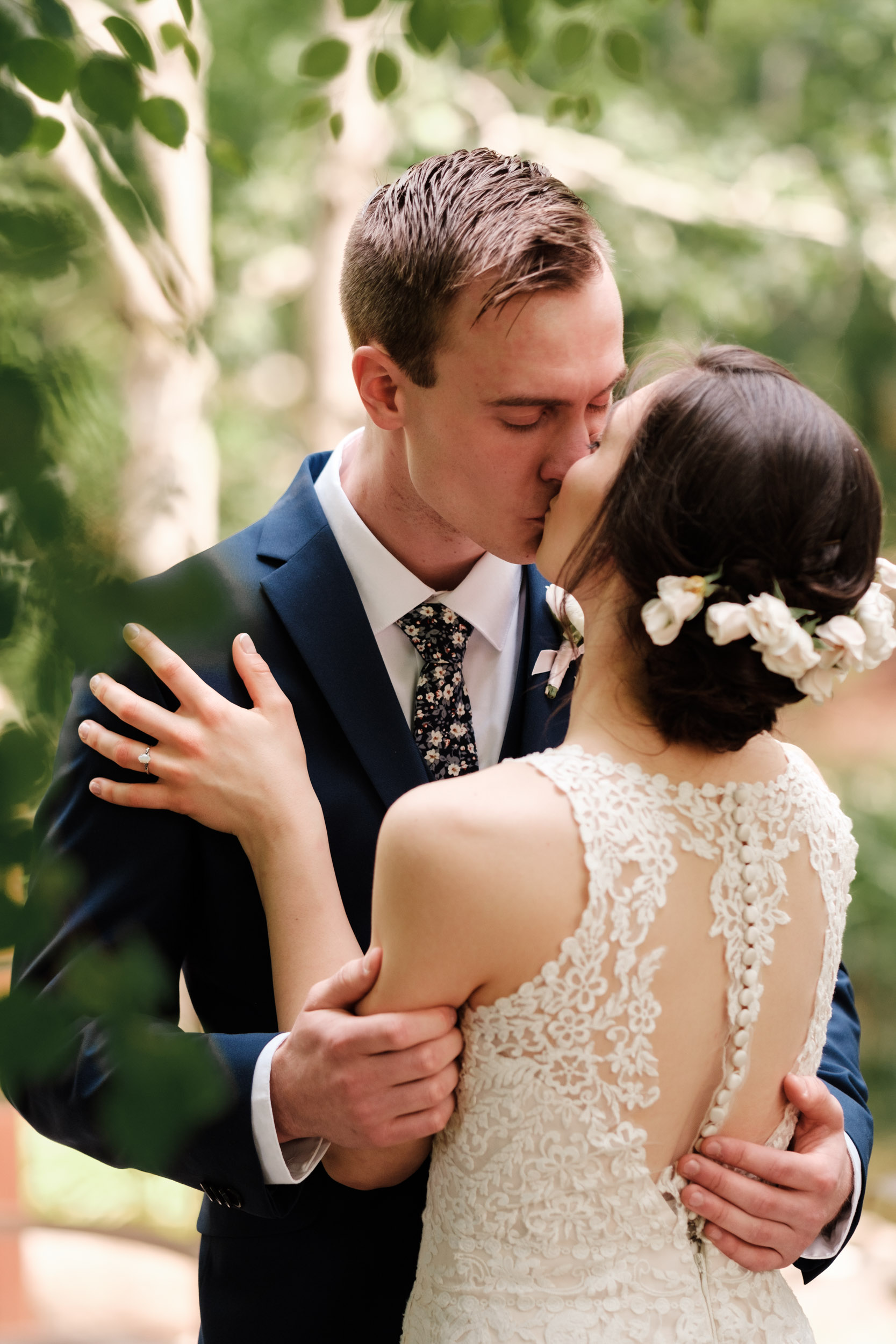 rockford wedding photographer natural first look gardens of woodstock bride floral crown and groom floral tie blue suit laughing