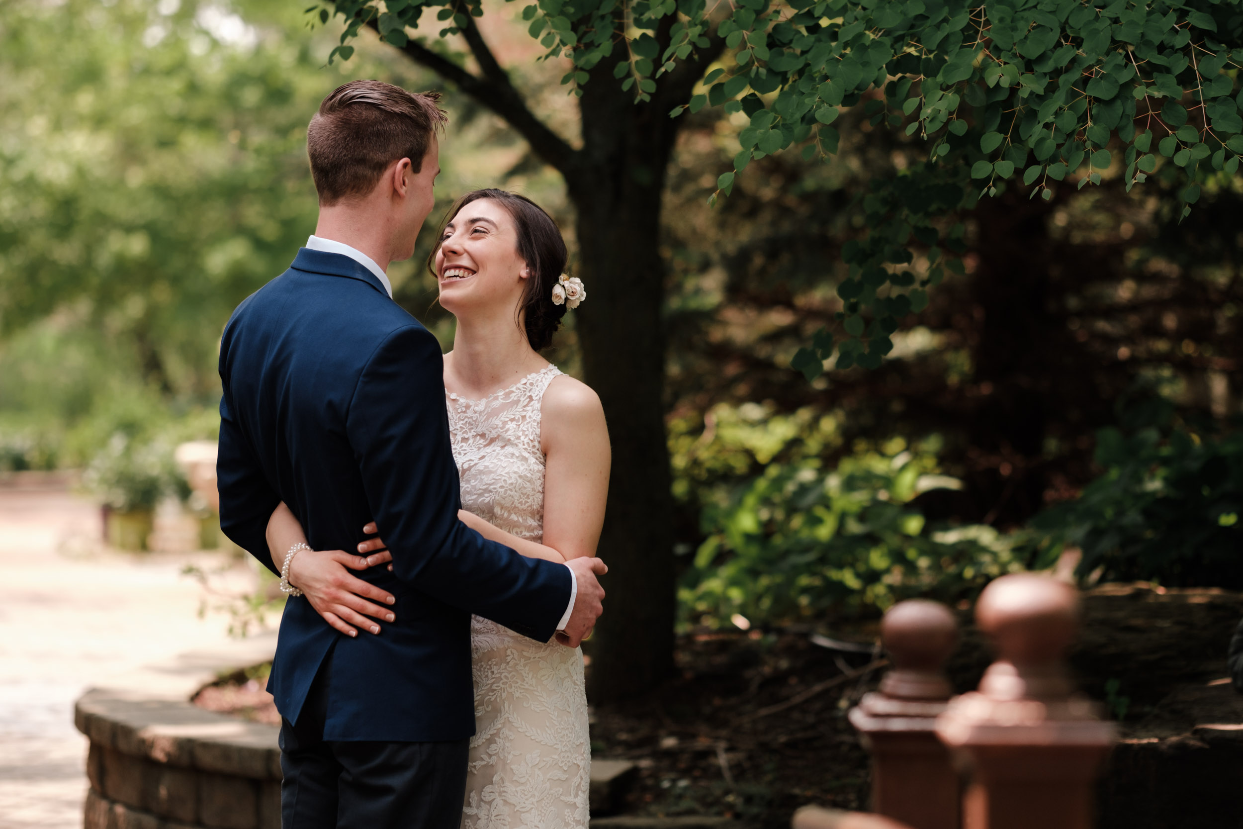 rockford wedding photographer natural first look gardens of woodstock bride floral crown and groom floral tie blue suit