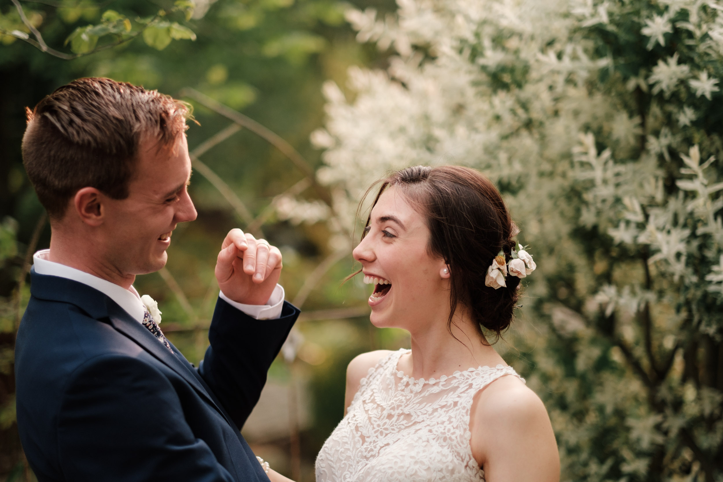 rockford wedding gardens of woodstock couple laughing in gardens after first look