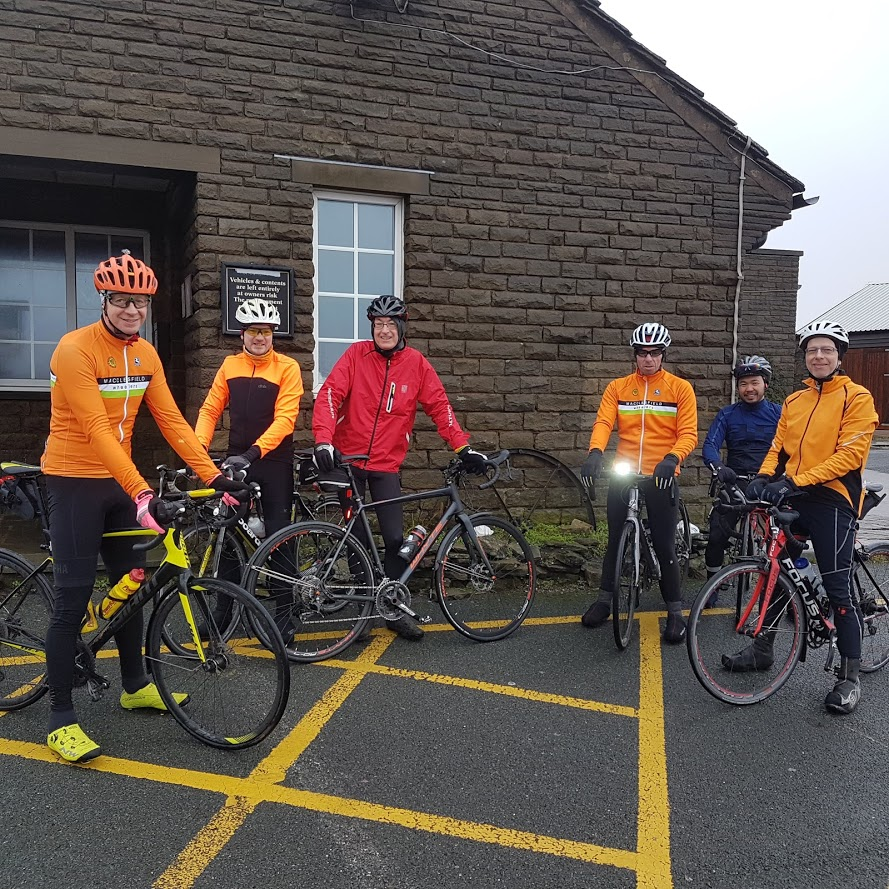 Sheltering from the wind at the top of the Cat. Mark, Simon, Steve, Christian (welcome to the Lark Ride Christian, very strong rides by you and Mark today), Bennet and Jochen.