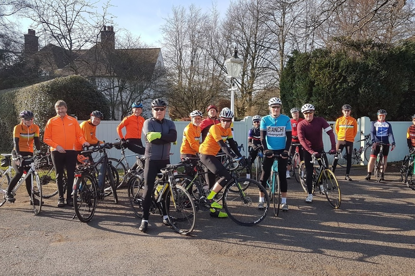 Larks line up with Larklings at base camp: Vikki, Simon, Steve, Dave, Andrew, Greg, Phil, Christian, hidden rider = new member Simon (welcome), Elliot, Steve, Matt, Mike, Ian, new rider Oliver (welcome), Mike.