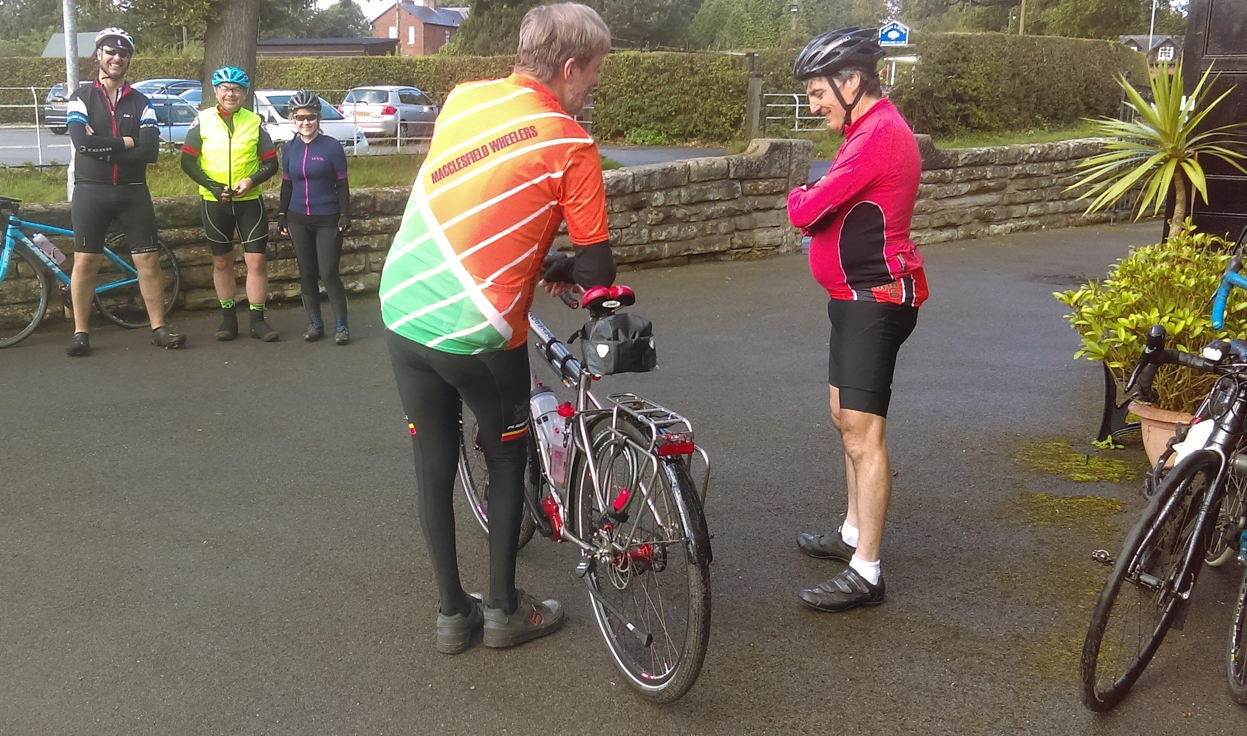 Spencer, Mark and Kirsten posing in height order whilst John admires Simon's new bike.