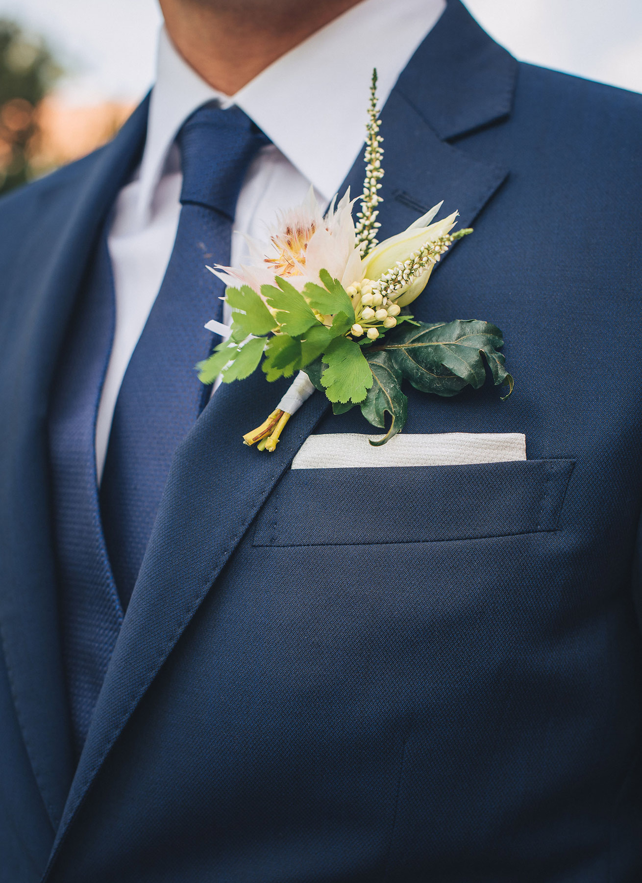 destination-wedding-groom-flowers