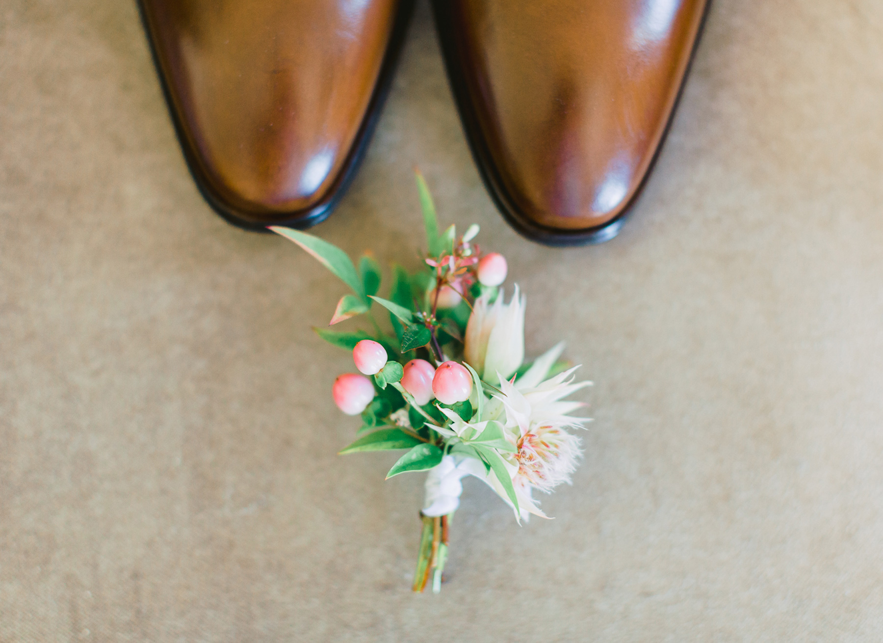 destination-wedding-groom-shoes-flowers