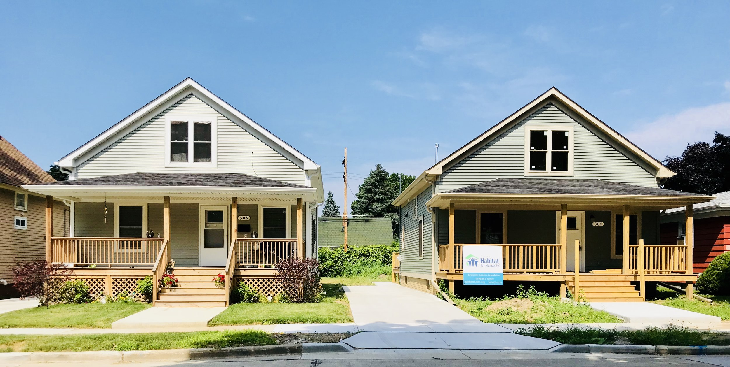 Two of our Habitat houses on Wickham Boulevard. The house on the left is finished, while the one on the right is nearly complete.
