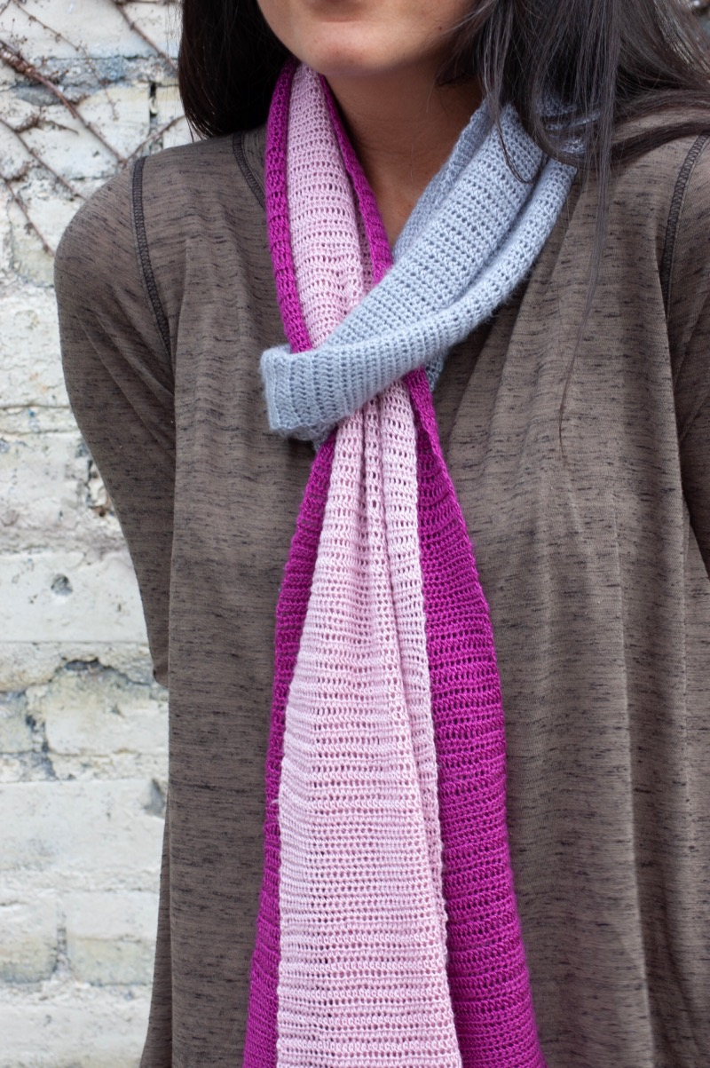 Misty Morning Scarf - by Abbey SwansonThis palette scarf showcases blocks of color from a misty morning on the Tibetan Plateau. Shy pinks and bolder buds splash against the grey sky. Adorn yourself with the artist's palette as you enjoy a cup of Tibetan tea. Made with our luscious yak/silk blend, this crocheted scarf has a gorgeous drape, while highlighting the incredible softness of yak down. It is both lightweight and warm and will add a pop of color to any outfit in any season.
