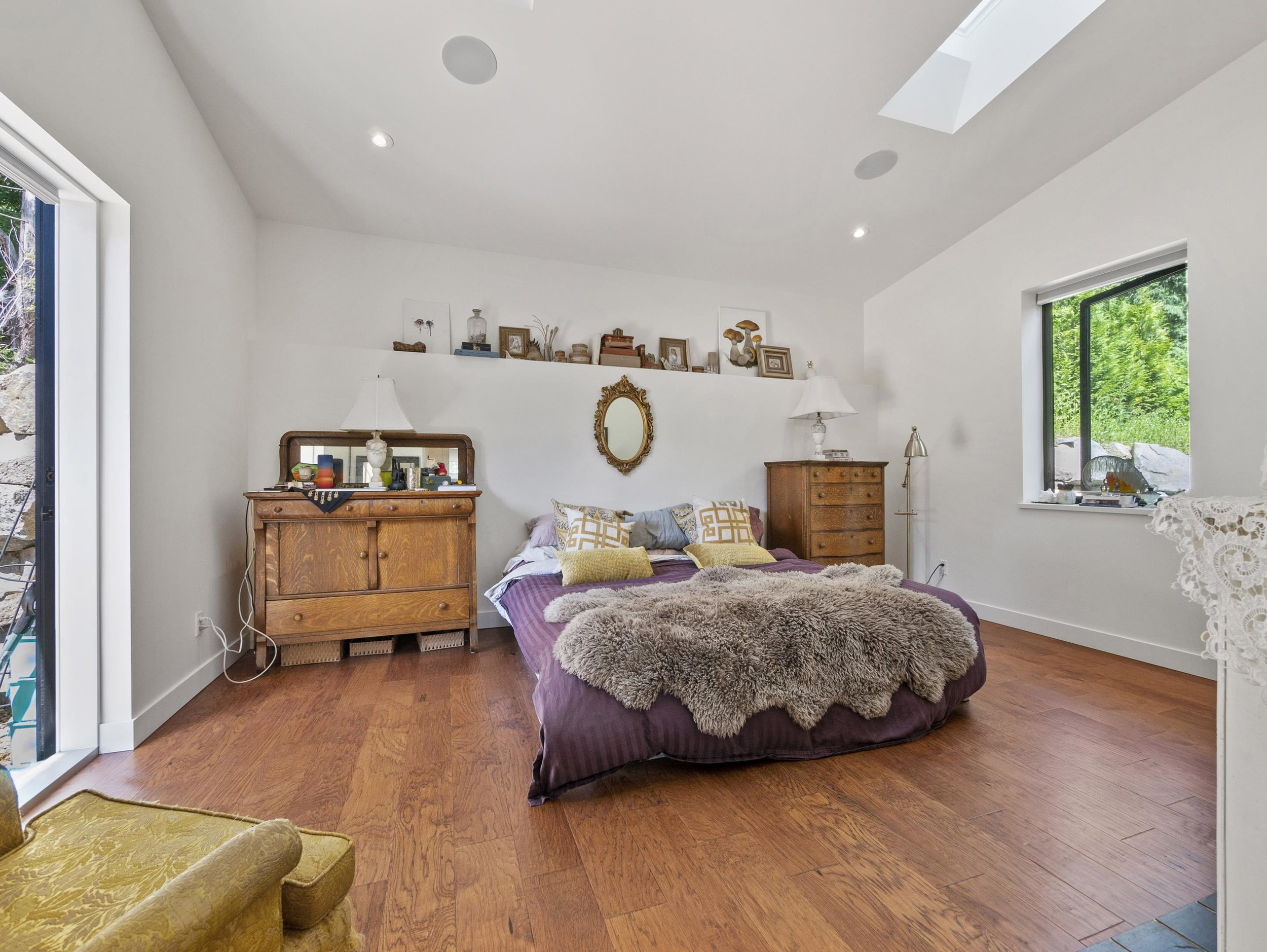 p32 master bedroom with fireplace and outside access_MJ.jpg