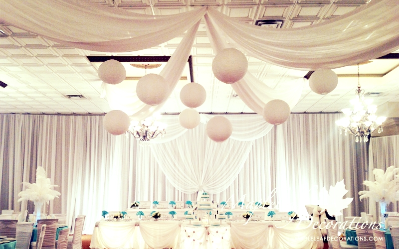 toronto-wedding-decorations-ceiling-draping-paper-lanterns-custom-wall-draping-montecasino-hotel-mapleleaf-decor-backdrop-head-table-cake-table-chair-covers-feather-centrepieces.jpg