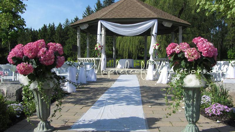 mapleleaf-decorations- wedding-ceremony-decor-gazebo-pew-bows-outdoors-royal_Ambassador.jpg