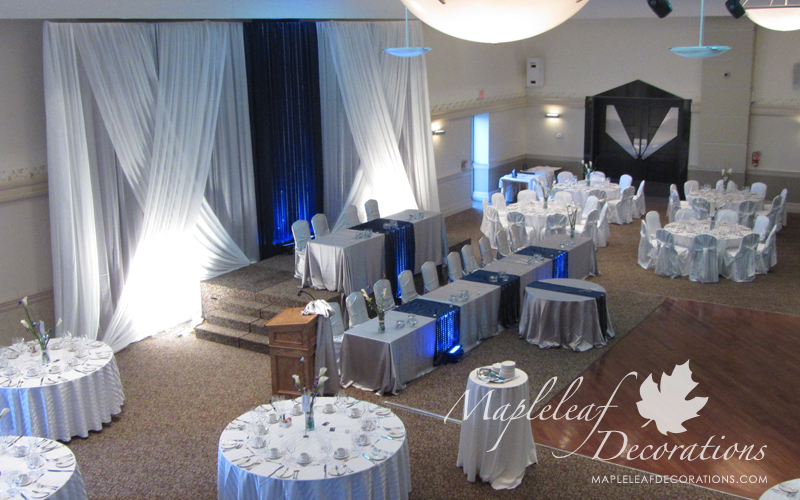 toronto-wedding-decorations-modern-backdrop-head-table-two-tiere-blue-navy-silver-satin-chair-covers-table-linens-overlays-runners-rental-grand-baccus-banquet-hall-scarborough-maple-leaf-decorators-crystals.jpg