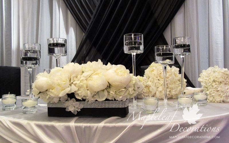 toronto-wedding-hall-decorations-backdrop-and-head-table-decor-la-primavera-banquet-hall-cafe-style-sweetheart-table-black-and-white-ivory-satin-peonies-candles-bling-accessories-montecassino.jpg