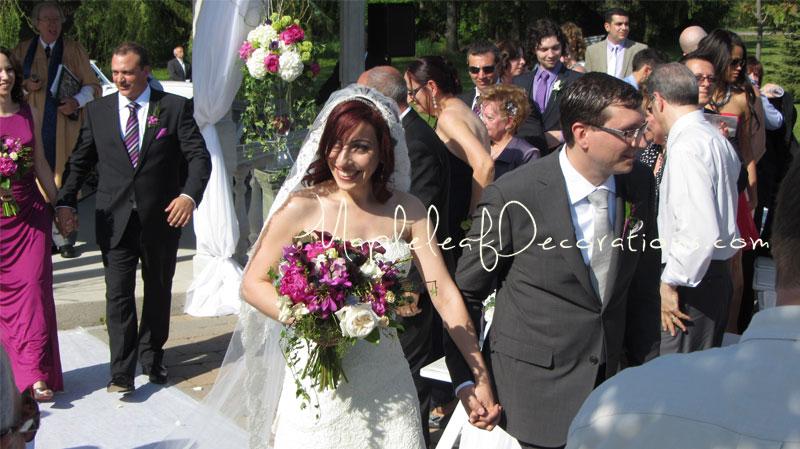 6-bride-and-groom-ceremony-decor-gazebo-pew-bows-outdoors-royal_Ambassador_may202012_teresa_mike.jpg