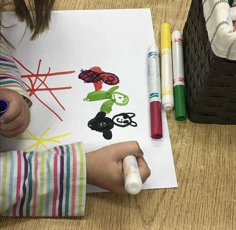 In the above picture, a student is drawing Spider-Man, The Hulk, and Batman. Listening to friends discuss the characters which were on their shirts inspired her to draw the picture and the shirts were used as models.