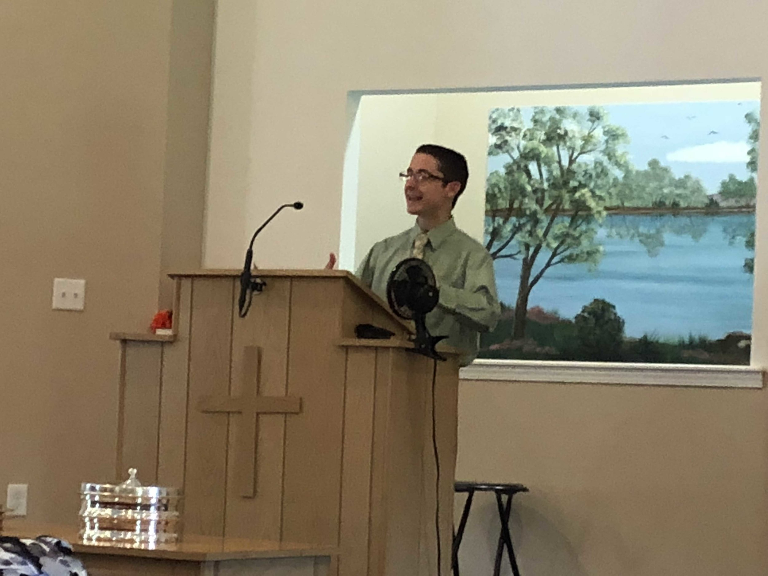 Photo of Nate Birt, author of Frozen, But Not Forgotten, speaking at a church.