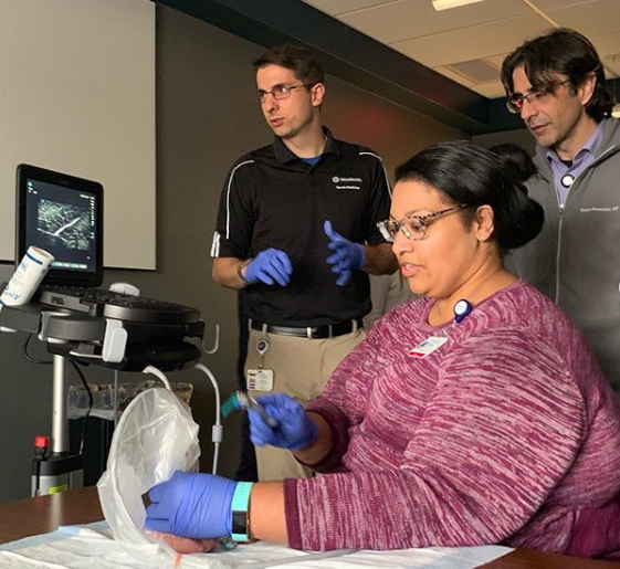 Dr. Poffel practices Ultrasound-Guided injections under the guidance of Dr. Bring while Dr. Demertzis observes