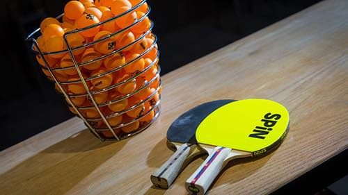 spin table tennis club paddles and balls