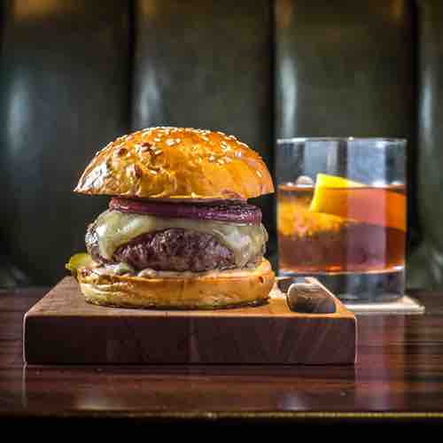 burger and cocktail at nomad bar