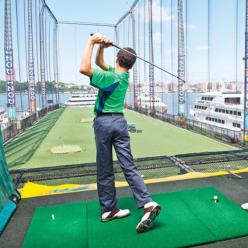 golfer at golf club at chelsea piers manhattan new york city
