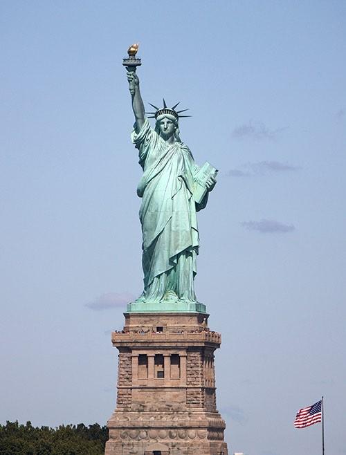 Copy of statute of liberty on pedestal new york city ny
