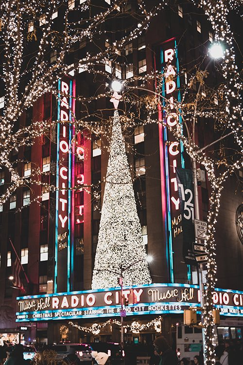 radio city marquee with christmas tree midtown manhattan new york city ny