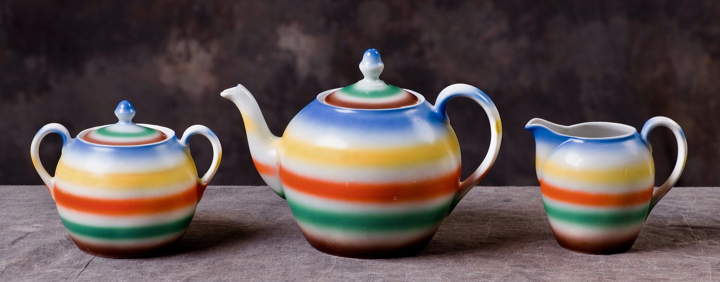 #104 Tea Pot, form 1875, Waldershof, ca.1930. Blue/green mfr.; Blind 1875; 10.8 cm H, 7.3 cm opening, 8.5 cm base Ø. RM172 #105 Sugar, form 1866, Waldershof, ca.1930. Blue/green mfr.; Blind 1866; 8 cm H (without lid), 6.5 cm opening, 7 cm base Ø. RM173 #106 Creamer, form 1806, Waldershof, ca.1930. Blue/green mfr.; Blind 1806; 8.5 cm H, 4.3 cm opening, 5.2 cm base Ø. RM174