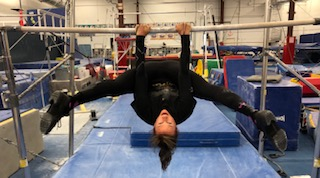 If you want to challenge your flexibility, try hanging straddle stretch