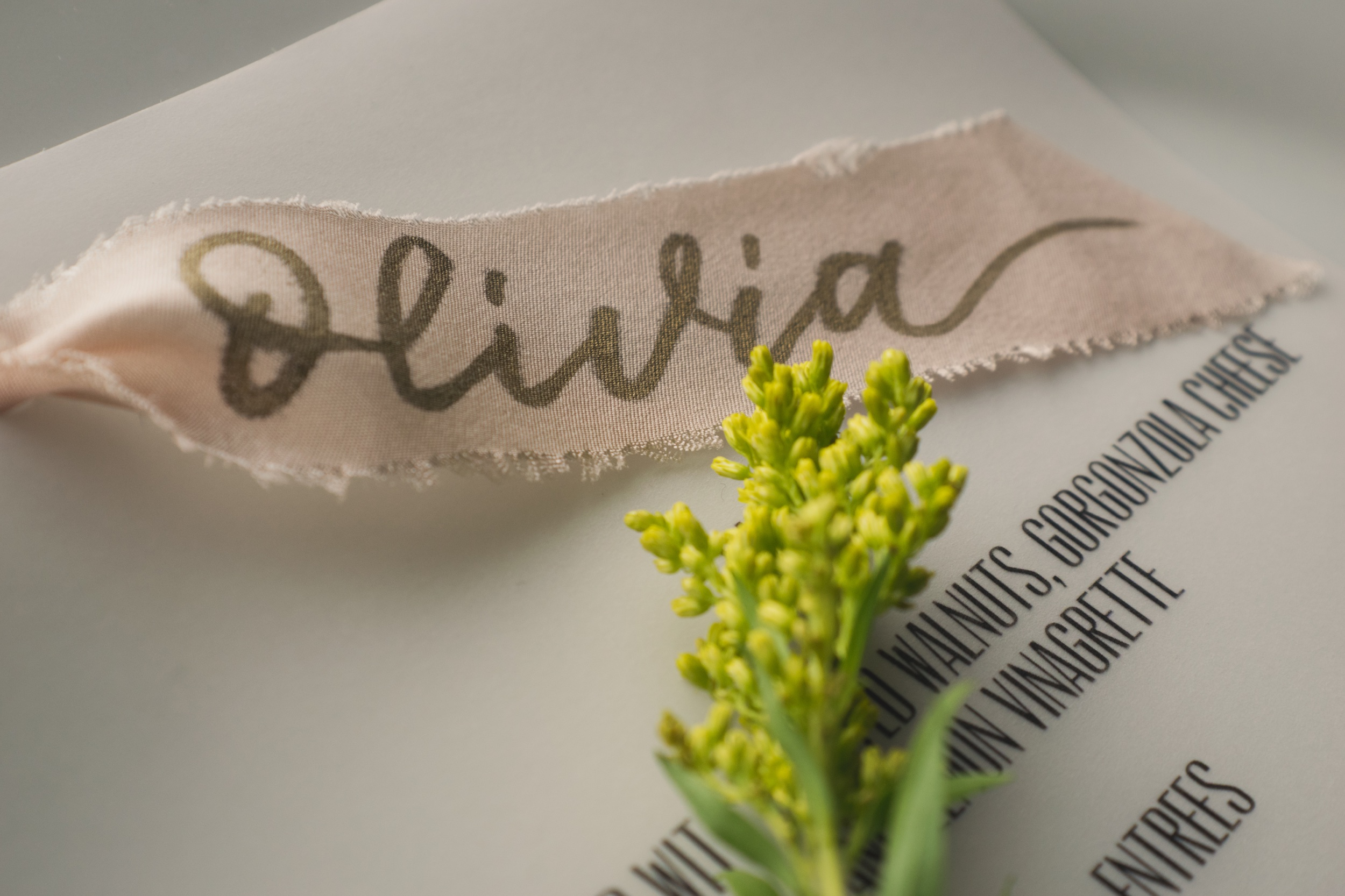 Silk ribbon place card on menu
