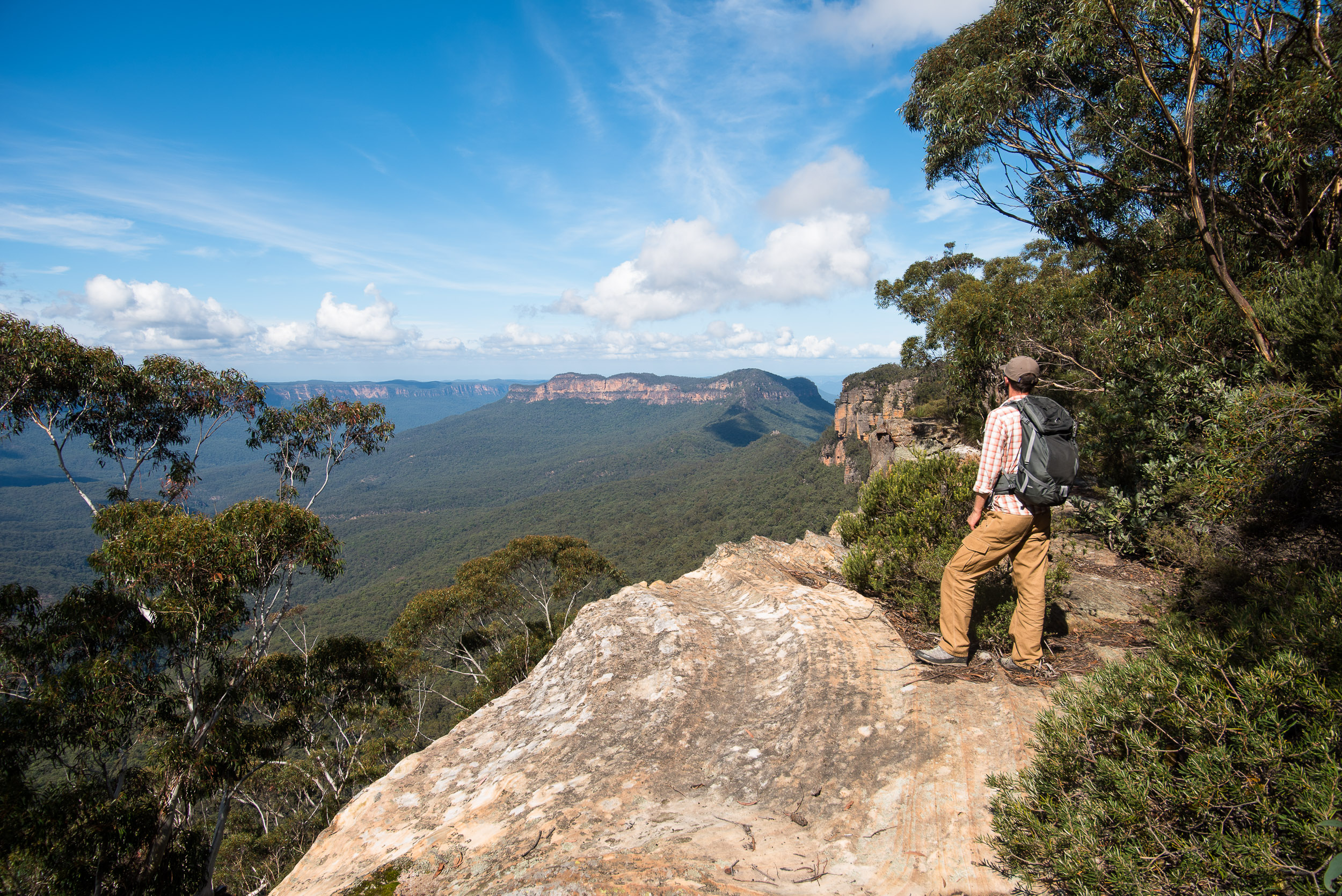 Thomas soaking in the views (and setting up a photo for his stock agency), while on a family picnic on Narrowneck. Mt Solitary in the distance, Blue Mountains, Australia.