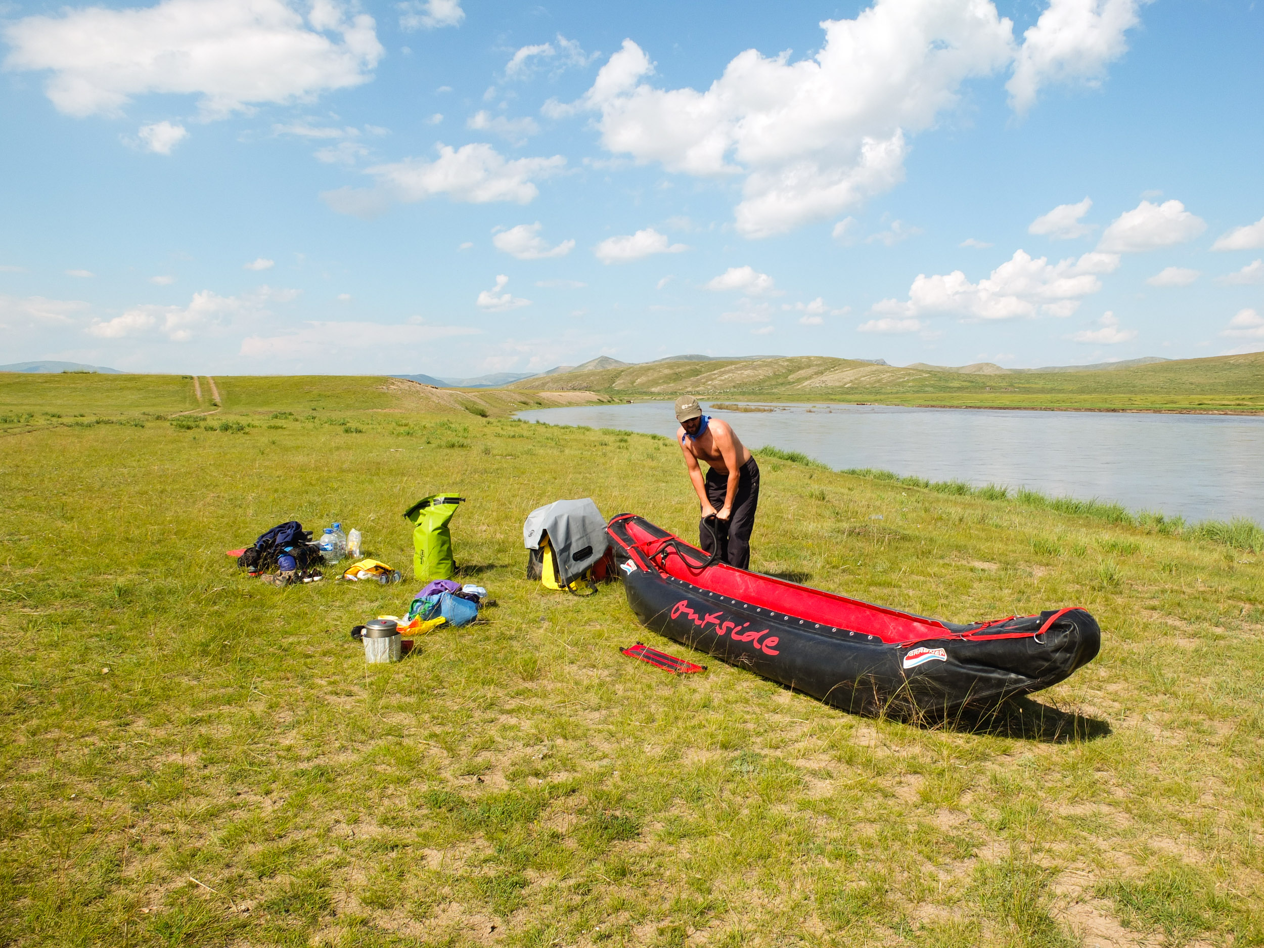 My good self, pumping up our raft at the put-in. Orkhon River, Mongolia. Photo by Jane.