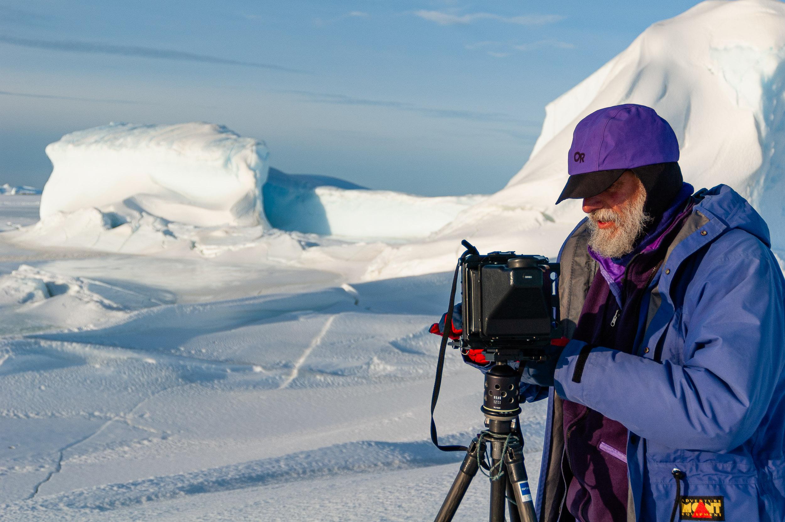 Photographer David Neilson in action, Vestfold Hills, Antarctica. © www.thomaspickard.com