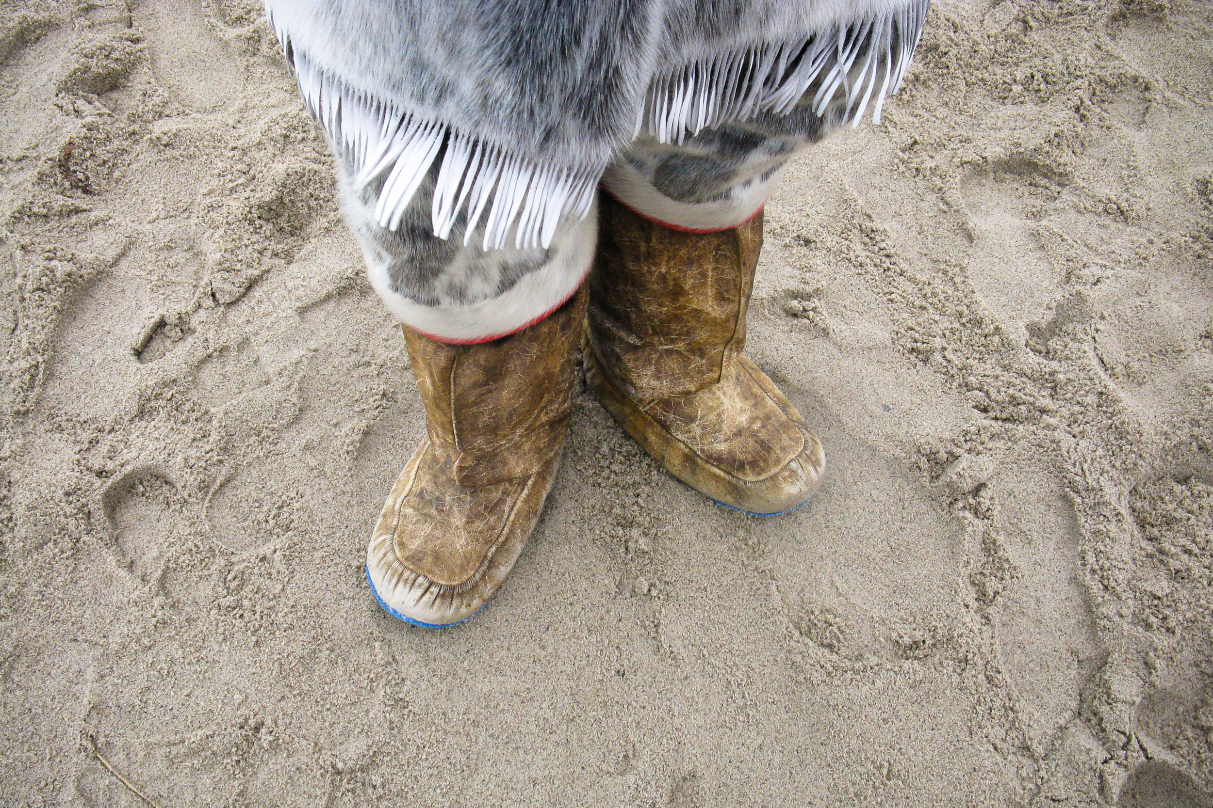 Inuit wearing traditionally made seal skin boots, Canada.