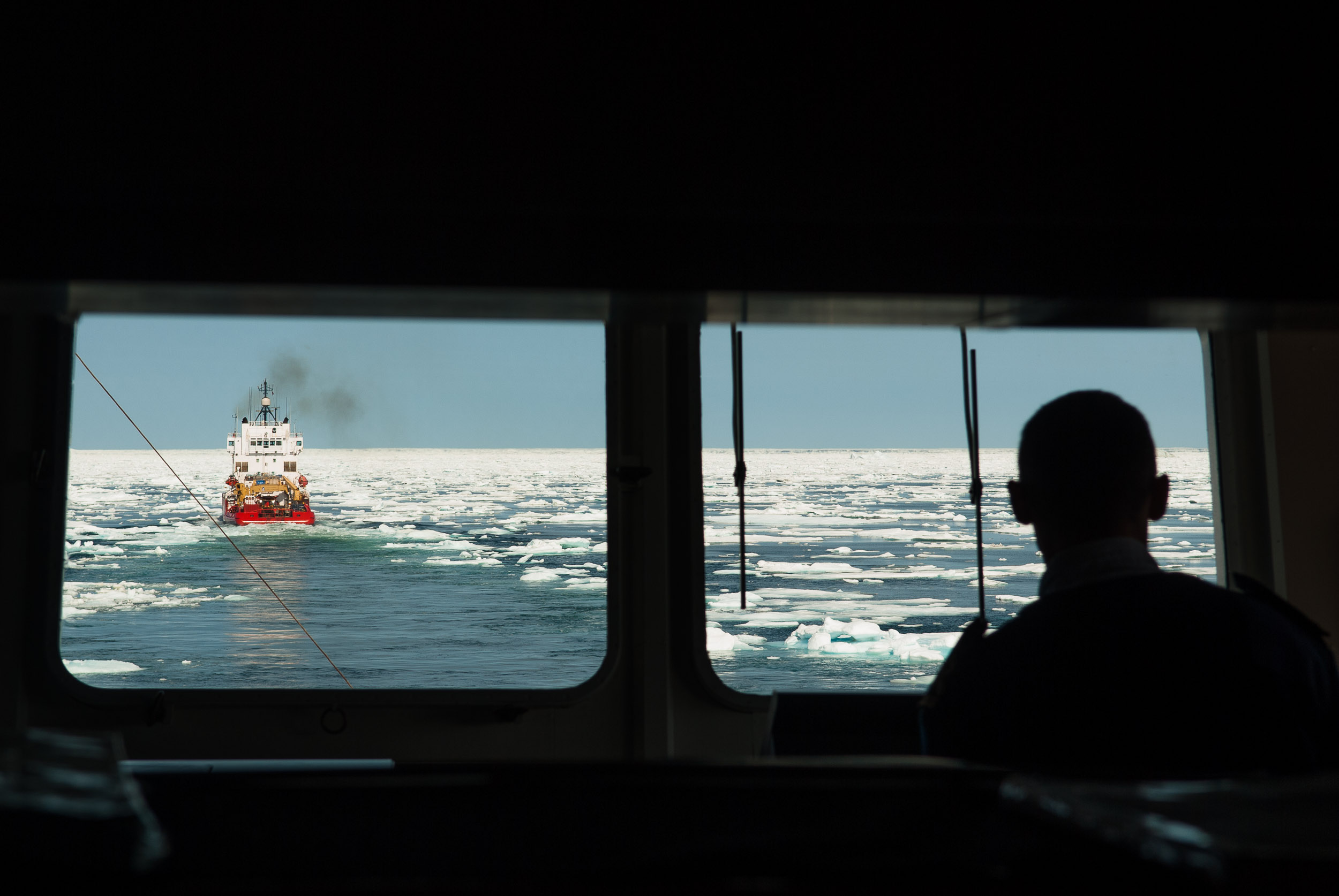 View from the Bridge of the  Akademik Ioffe , of the Ice breaker the  Terry Fox  clearing a path through heavy pack ice, for the polar cruise ship the Akademik Ioffe, Baffin Island, Canada.