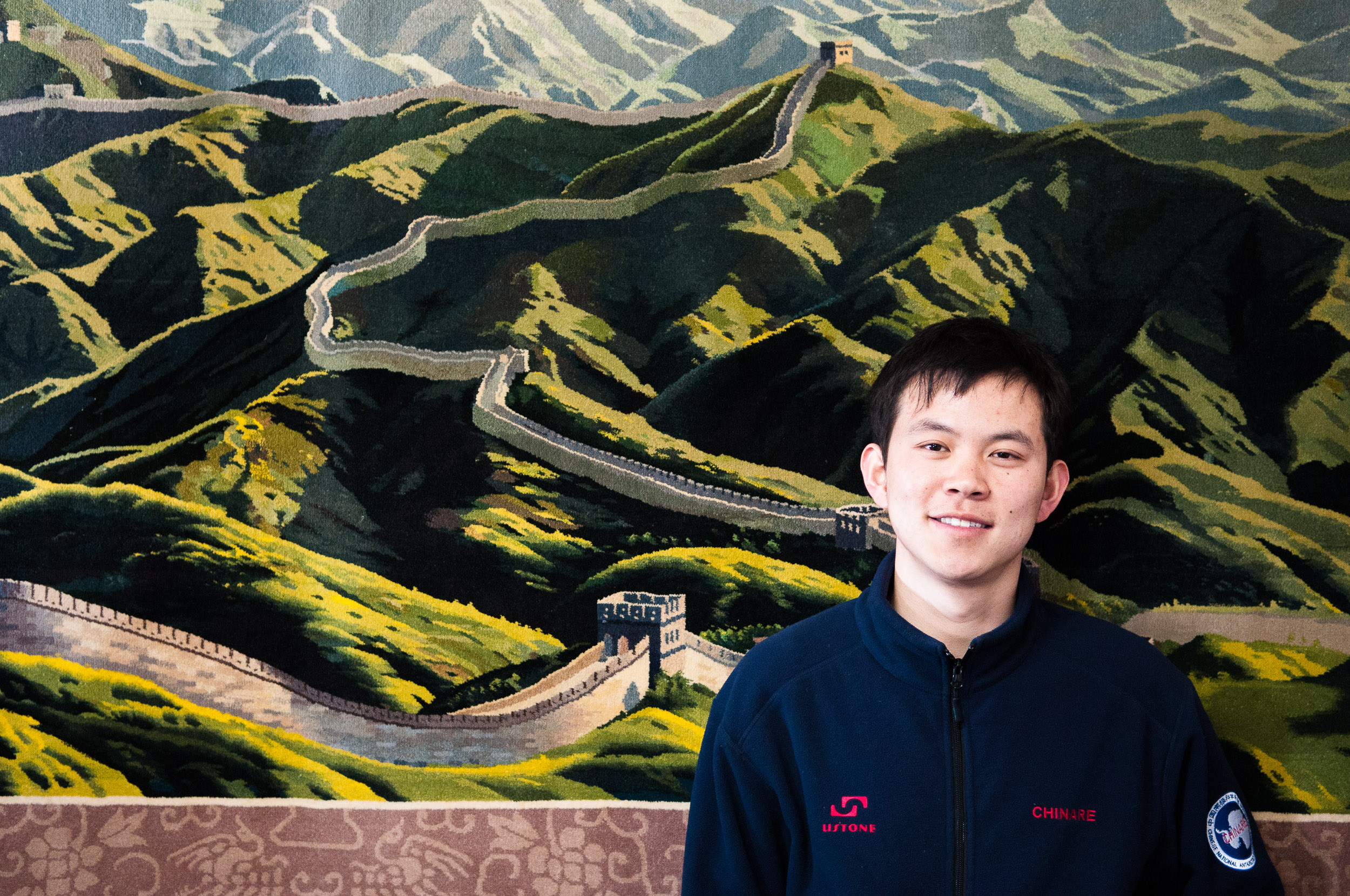A Chinese Weather Forecaster poses for a portrait with the Great Wall as a back drop. Great Wall Station, King George Island, South Shetland Islands, Antarctica. Chinese researchers spend two-year stints at the Great Wall station.