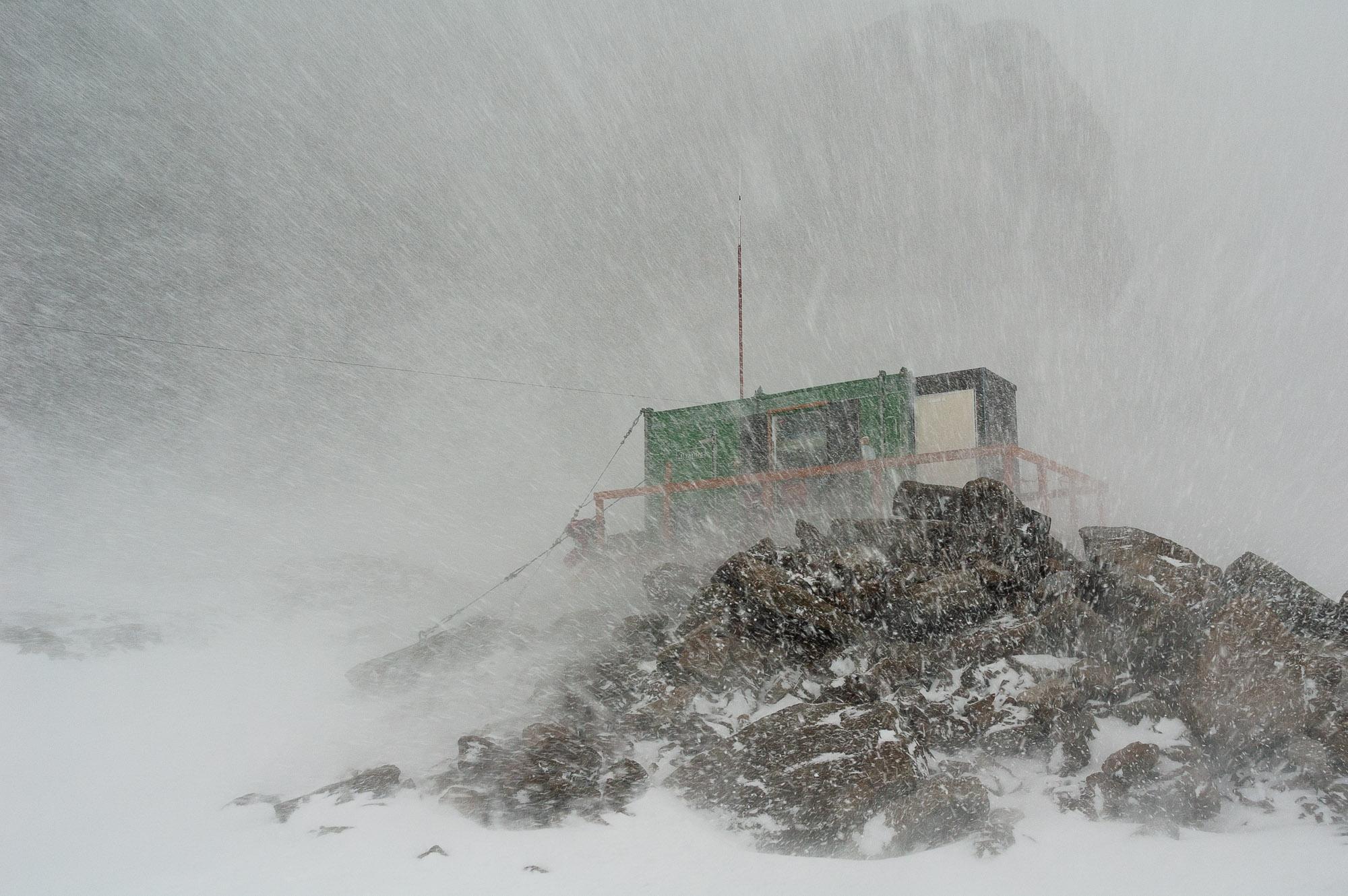 Rumdoodle Hut in a blizzard, North Masson Range, Framnes Mountains, Mac Robertson Land, Antarctica.