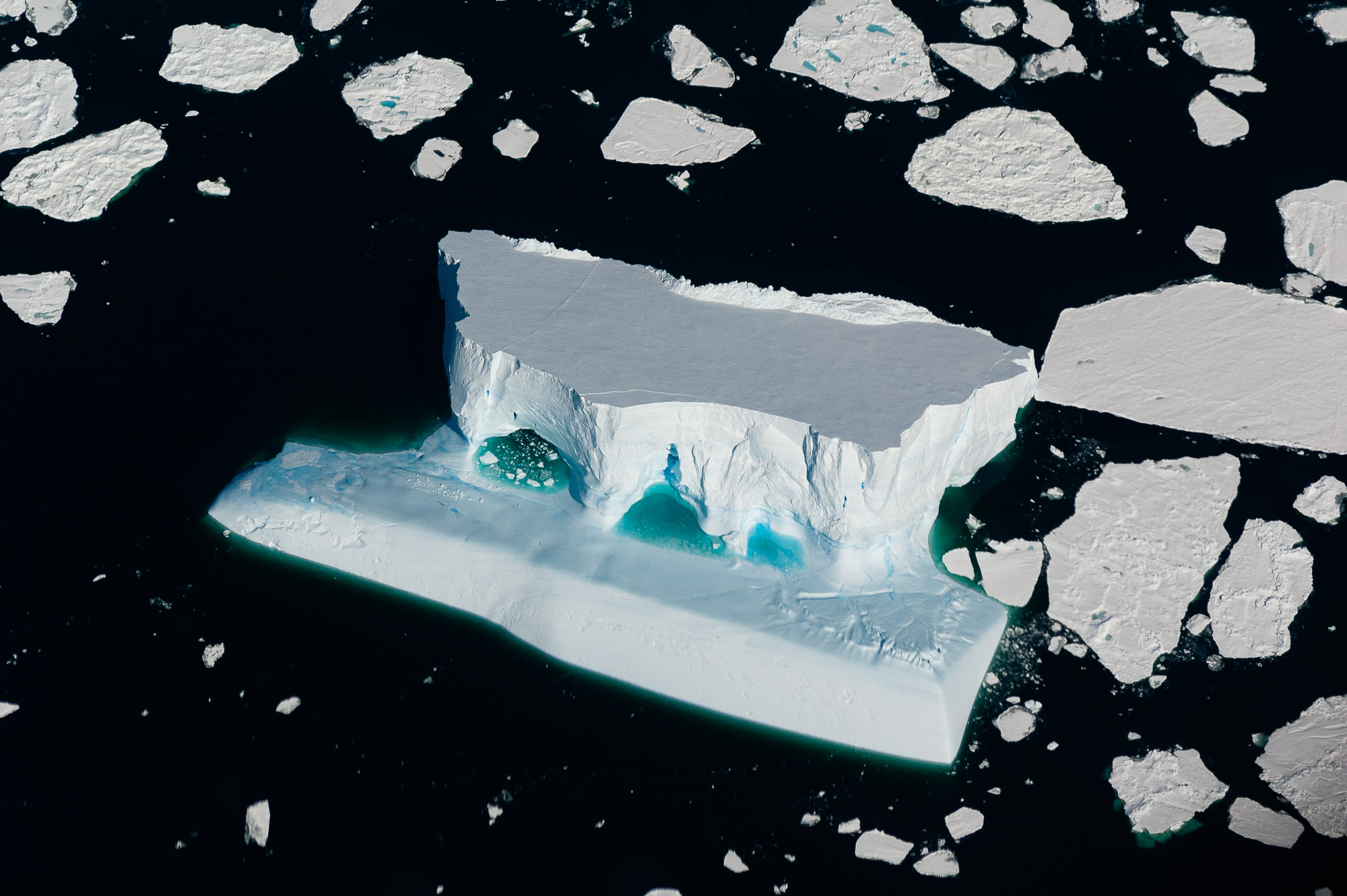 Aerial view of an iceberg, while flying from Mawson Station to Davis Station. Prydz Bay, Antarctica,