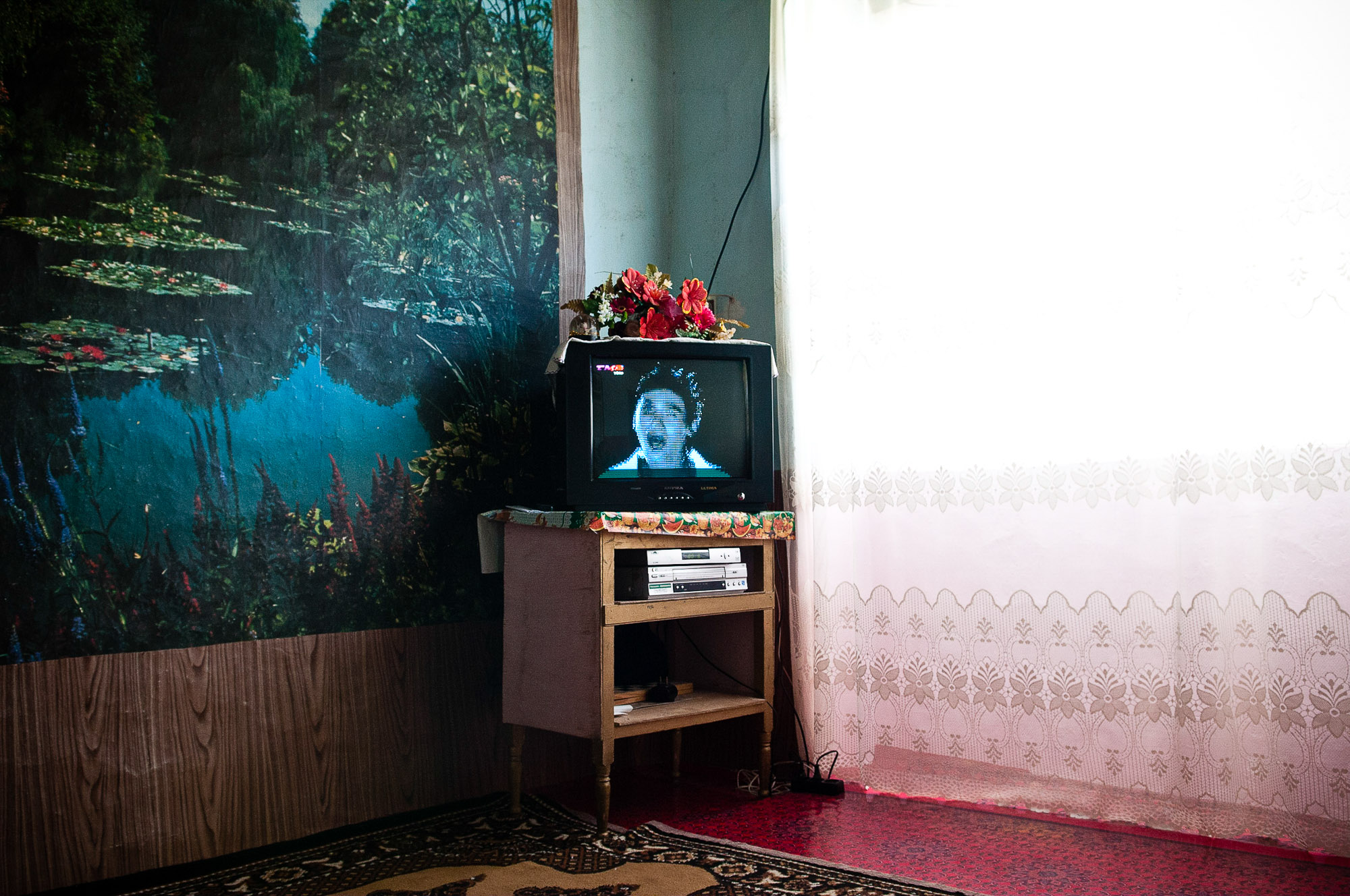 Television playing in a house, Xinaliq, Azerbaijan. © www.thomaspickard.com