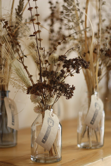 Dried stems of sedum - the dark spray-type material in front combined with dried gomphrena, grasses, seeded basil stems and daucus seedheads