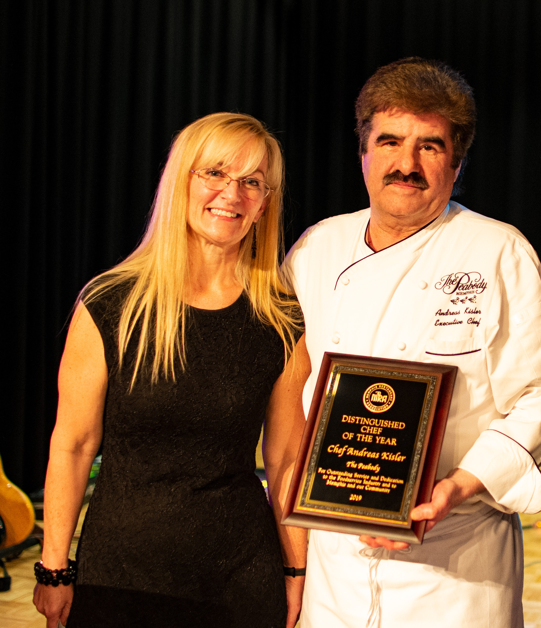 Chef Andreas Kisler accepting Chef of the Year award at the Peabody 55th annual MRA banquet