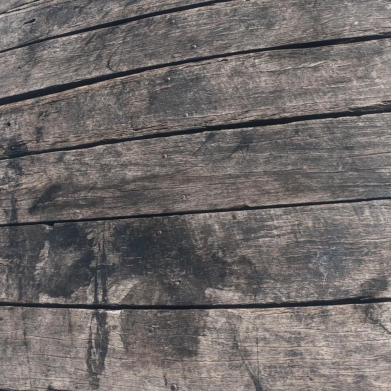 Squid ink splashed up on the pier in Port Elliott