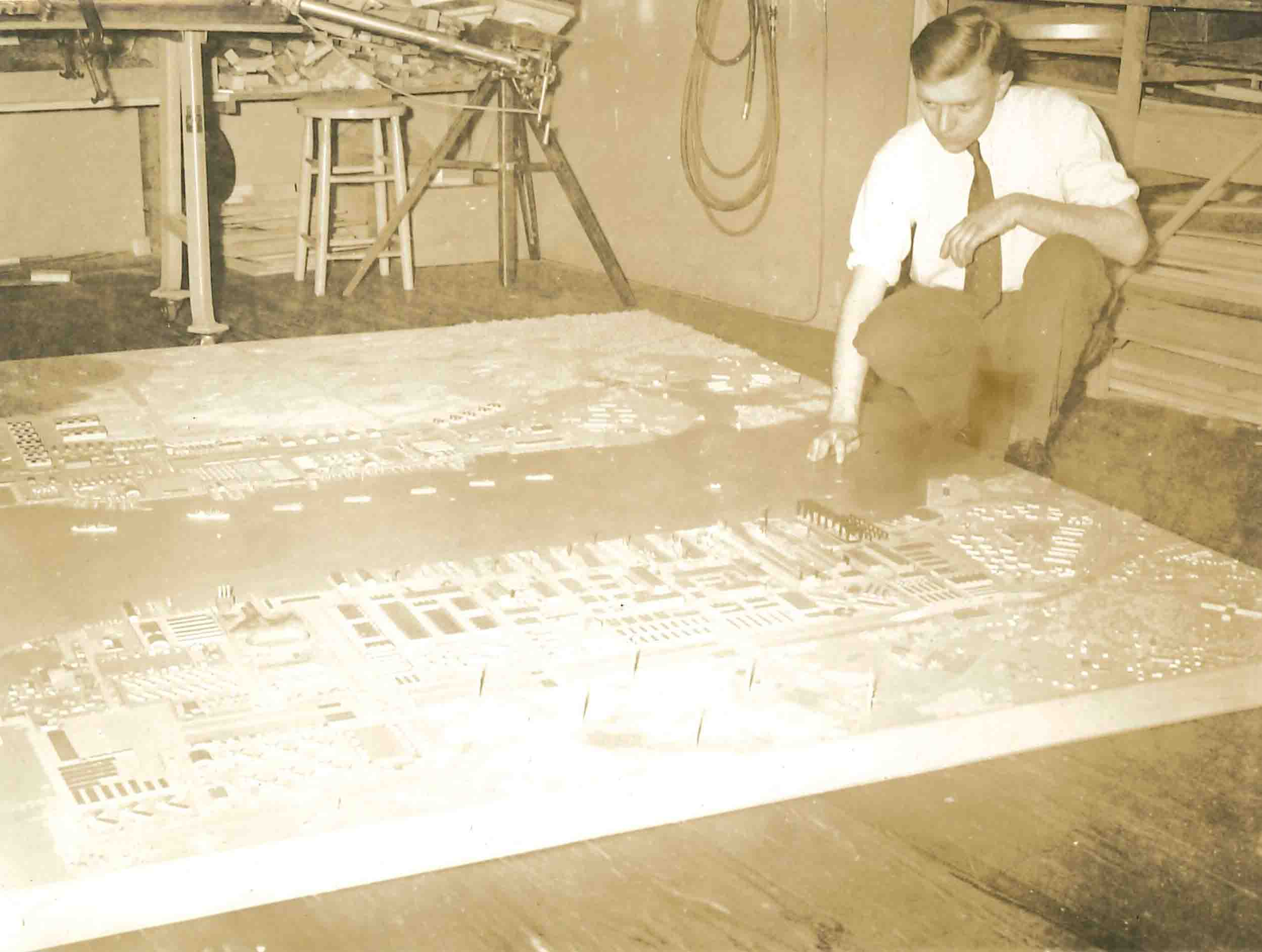 - Theodore Conrad with his model of the Fortune Naval Base, 1940, photographer unknown