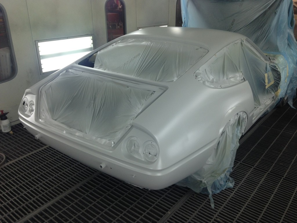 Once the epoxy primer sets up we then went back over her with a spray filler that puts a nice even coat of filler over the entire surface. This step allow us to go back and block the entire car yet once again. When doing body work you have to spread filler over the panels and then block with several grits of sandpaper. As you sand you transition through the different layers of body filler. You can never get it truly straight to the level of perfection required without priming or the use of a spray filler. We prefer spray filler due to it getting hard enough to seal the under layer body fillers.