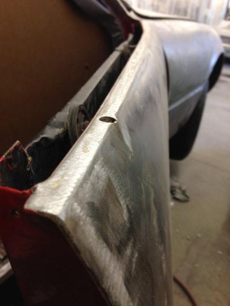When we got the car the handle bump outs were flat. Here is an image showing the handle bump out on the passenger door. These will be very important because this 1971 364 GTB/4 Ferrari Daytona is getting painted Argento Silver. These little accent bumps will add amazing character to the body of the car. Silver is an amazing color for the car but without a doubt, the most difficult color to paint. You see every flaw do to the way the metal lays on the body.