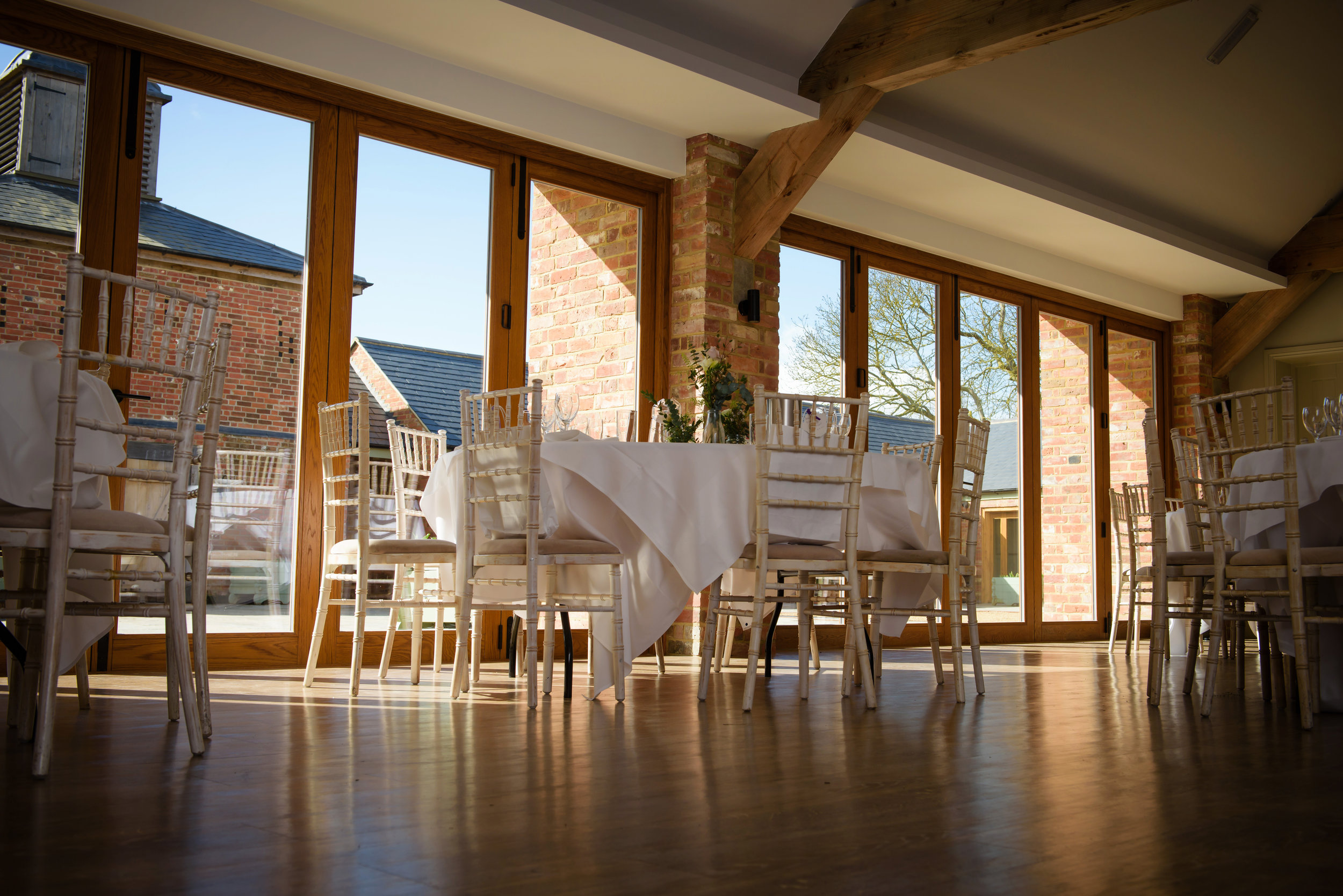 """- The New Barn is the newest addition to the courtyard buildings at Apton Hall, it features our """"wishing well"""", found when renovating the barn in 2016.Creating the perfect setting for your wedding breakfast with bi-fold doors opening up on to the courtyard on those hotter summer nights and with an extension to double the size of the room to host up to 200 covers."""